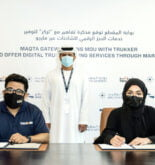 Dr Noura Al Dhaheri, Head of Abu Dhabi Ports' Digital Cluster, and CEO of Maqta Gateway, and Gaurav Biswas, Founder and CEO of TruKKer, sign an agreement to offer customers truck booking services through MARGO
