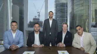 Mycrane founder Andrei Geikalo, standing, is pictured with new franchise partners following the signing of partnership agreements in Dubai